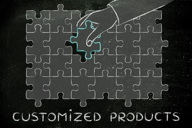 hand completing a puzzle, with text Customized Products